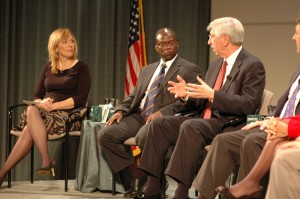 Panelist Dr. Myles Brand talking with Moderator Linda Cohn and fellow panelist Stuart Robinson.