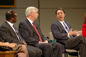 George Bodenheimer talking with fellow panelists Stuart Robinson and Dr. Myles Brand.