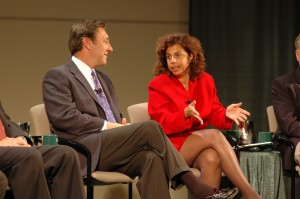 Linda Bruno talking with fellow panelist George Bodenheimer.