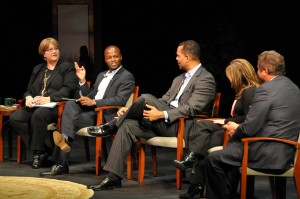 Kendis Gibson talking with the other panelists during  the 2011 Media Summit.