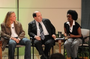 Candace Dunkley talking with fellow panelists J. Scott Dinsdale and Steve Leblang.
